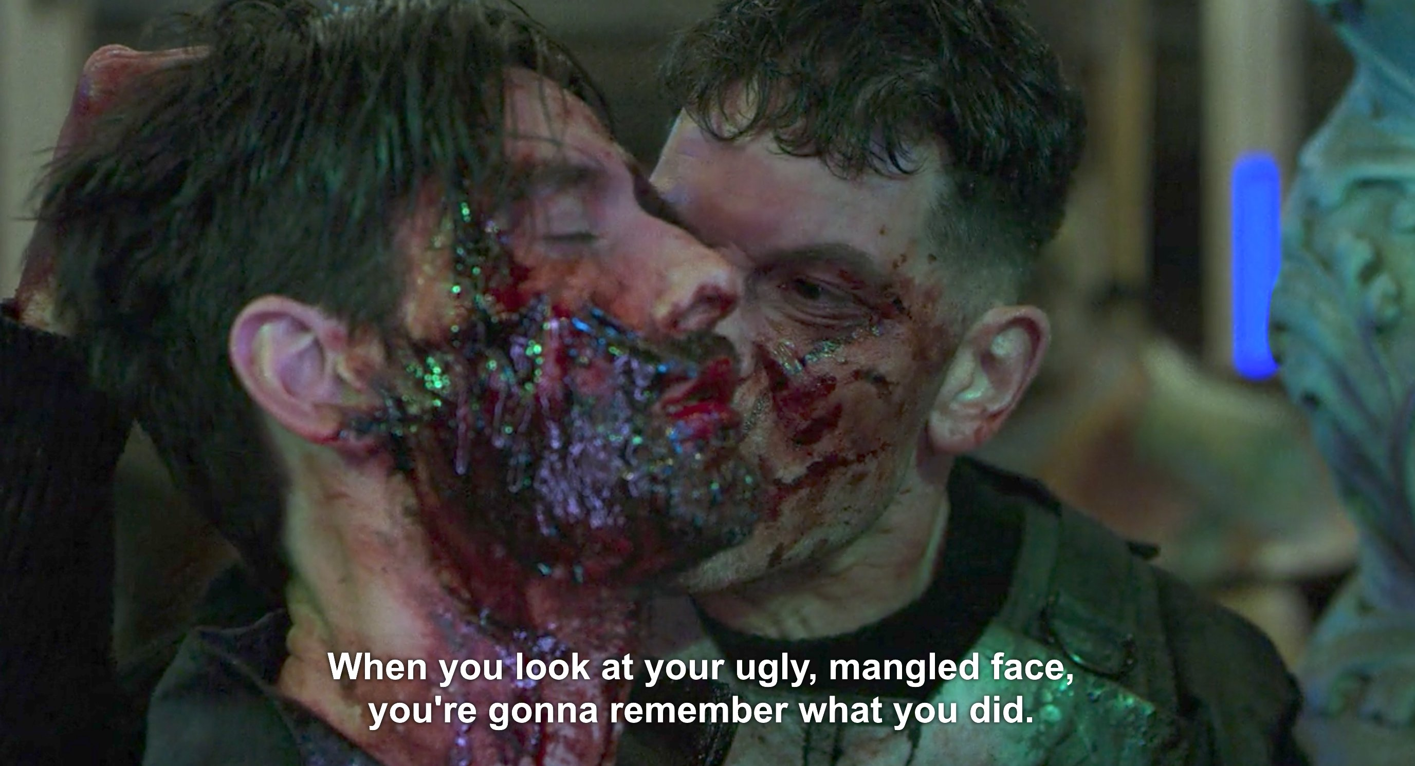 "Screenshot of Netflix's Punisher season 1 finale, subtitled: ""When you looked at your ugly, mangled face, you're gonna remember what you did."""